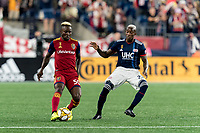 FOXBOROUGH, MA - SEPTEMBER 21: Sam Johnson #50 of Real Salt Lake passes the ball as Luis Caicedo #27 of New England Revolution closes during a game between Real Salt Lake and New England Revolution at Gillette Stadium on September 21, 2019 in Foxborough, Massachusetts.