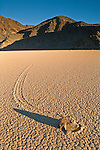 Tracks left by mysterious moving rocks on the dried flat mud at the Racetrack Playa, Death Valley National Park, California