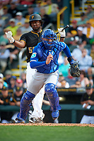 Toronto Blue Jays catcher A.J. Jimenez (8) retrieves the ball after blocking a pitch with Josh Bell (55) batting during a Spring Training game against the Pittsburgh Pirates on March 3, 2016 at McKechnie Field in Bradenton, Florida.  Toronto defeated Pittsburgh 10-8.  (Mike Janes/Four Seam Images)
