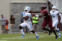 BLACKSBURG, VA - OCTOBER 19: Michael Carter #8 of the University of North Carolina is chased down by Chamarri Conner #22 of Virginia Tech during a game between North Carolina and Virginia Tech at Lane Stadium on October 19, 2019 in Blacksburg, Virginia.