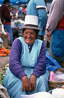 A cheese vendor in Pisac Market, the Sacred Valley of the Incas, Peru. These tall Panama hats are worn by all the women in the area.