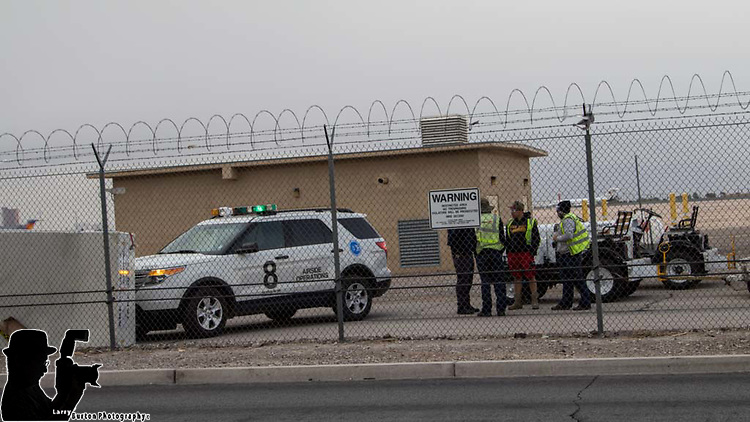 2017-03-30 High winds in Las Vegas appears to have blown an airplane cargo container all the way accross the runways and stopped at the fence line on sunset