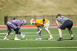 Jamie Piluso (25) of the High Point Panthers and Phil Poe (33) of the UMBC Retrievers prepare for a faceoff at Vert Track, Soccer & Lacrosse Stadium on March 15, 2014 in High Point, North Carolina.  The Panthers defeated the Retrievers 17-15.   (Brian Westerholt/Sports On Film)