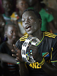A displaced man sings and plays the tambourine during mass in a makeshift chapel inside a United Nations base in Malakal, South Sudan. More than 20,000 civilians have lived inside the base since shortly after the country's civil war broke out in December, 2013, and renewed fighting in 2015 drove an additional 5,000 people into the relative safety of the camp. Maryknoll Father Mike Bassano lives in the camp to accompany the people there.