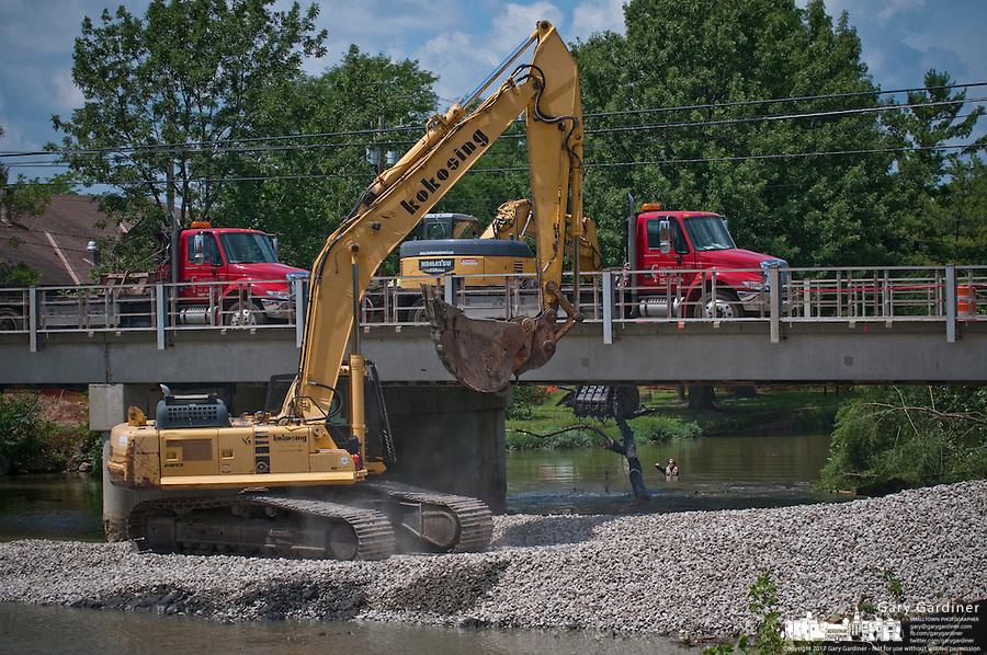 Temporary gravel roadway built beside Main Street Bridge during construction