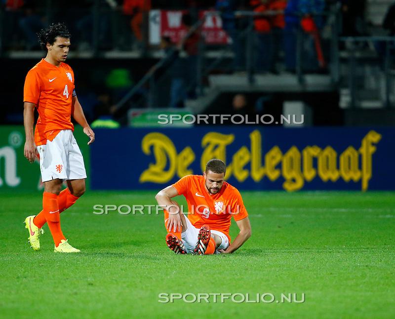 Nederland, Alkmaar, 9 oktober 2014<br /> Play-offs EK-kwalificatie<br /> Jong Oranje-Jong Portugal<br /> Teleurstelling bij Karim Rekik, aanvoerder van Jong Oranje en Luc Castaignos