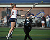 Erin Barry #2 of Manhasset, left, tries to get a shot past Long Beach goalie #10 Sarah Reznick during the first half of a Nassau County varsity girls lacrosse game at Manhasset High School on Friday, Apr. 15, 2016. Manhasset won by a score of 9-8.