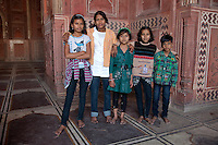 Agra, India.  Taj Mahal Mosque.  Four Young Indian Girls and One Boy.