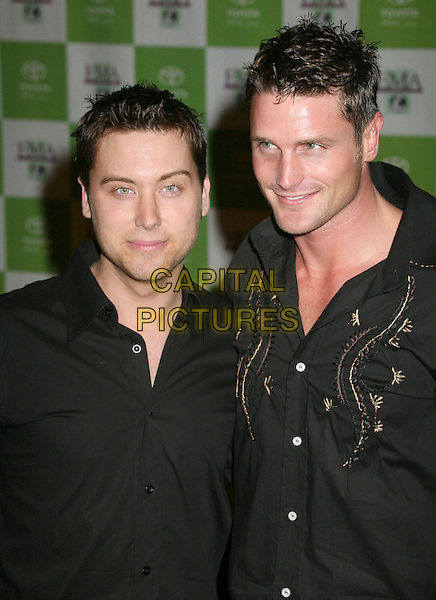 LANCE BASS & REICHEN LEHMKUHL.16th Annual Environmental Media Awards at the Ebell Club of Los Angeles,  Los Angeles, California, USA,.08 November 2006..half length .CAP/ADM/BP.©Byron Purvis/AdMedia/Capital Pictures. *** Local Caption *** .