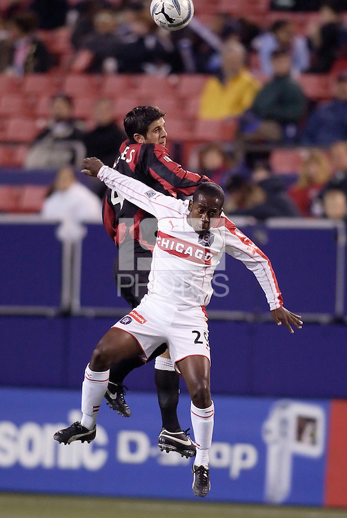 The MetroStars' Carlos Mendes and Thiago of the Fire go up for a header. The Chicago Fire defeated the MetroStars 1 - 0 at Giant's Stadium, East Rutherford, NJ, on Friday April 22, 2005.