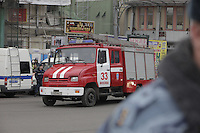 Moscow, Russia, 29/03/2010..Scenes outside Lubyanka metro station, where at least 24 people were killed in a morning rush hour suicide bombing. A second bomb exploded at Park Kultury metro station, killing at least another 14 people. Fire engine arrive at Lubyanka square..