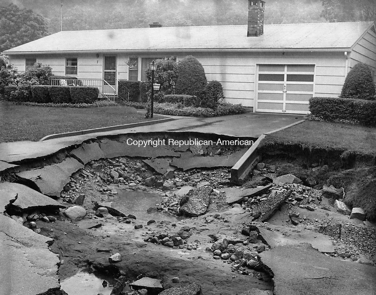 Raging currents from flooding in 1982 undermined the driveway of this home in Naugatuck.