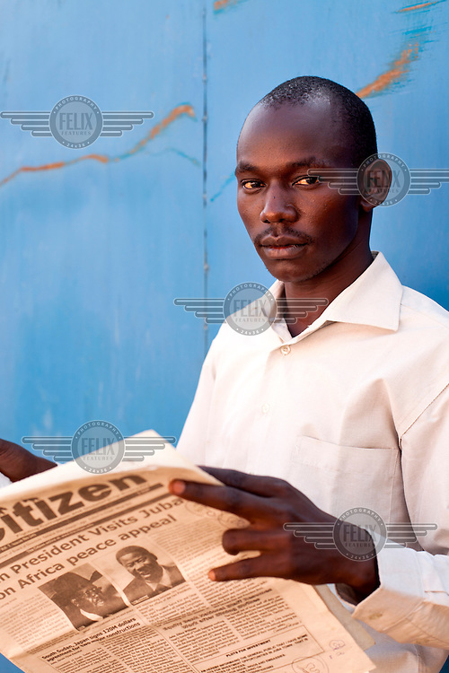 A man reading the Citizen newspaper.