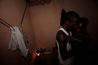Rosina, on right, a young sex slave, meets a client  while preparing to cross the boarder with Togo searching for customers  in her neighborhood  in Aflao in the Volta Region, Ghana on Friday March 09 2007....
