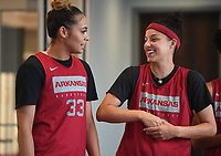 NWA Democrat-Gazette/J.T. WAMPLER Guards Chelsea Dungee (LEFT) and Amber Ramirez wait their turn to talk to the media Wednesday Oct. 9, 2019 at the Arkansas Basketball Performance Center.
