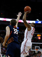 Ohio State Buckeyes guard Lenzelle Smith Jr. (32) shoots over Illinois Fighting Illini forward Jon Ekey (33) in the first half at Value City Arena in Columbus Jan. 23, 2013 (Dispatch photo by Eric Albrecht)