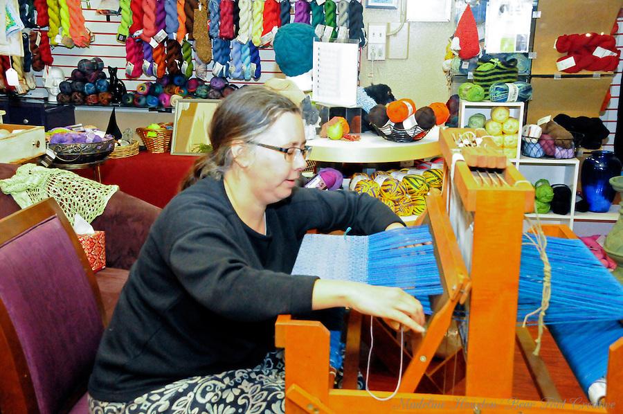Jen demonstrates weaving at Loose Ends Fiber Arts during Centralia, Washington's Third Thursday on October 20, 2016.