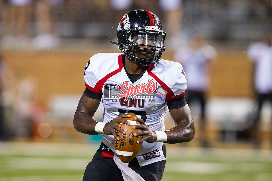 Gardner-Webb Runnin' Bulldogs quarterback Tyrell Maxwell (12) rolls out to his right during second half action against the Wake Forest Demon Deacons at BB&T Field on September 6, 2014 in Winston-Salem, North Carolina.  The Demon Deacons defeated the Runnin' Bulldogs 23-7.   (Brian Westerholt/Sports On Film)