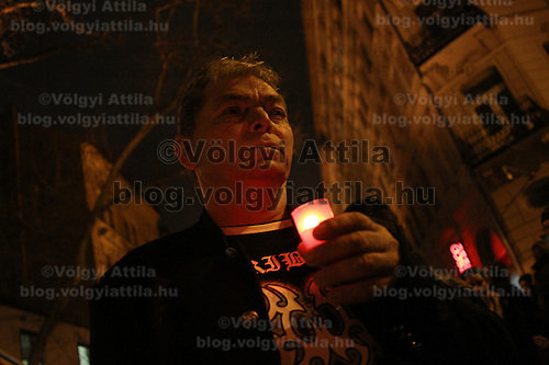 Csaba Csorba relative of the romas killed in 2009 in Tatarszentgyorgy holds a candle during a commemirative event in Budapest, Hungary on February 23, 2012. ATTILA VOLGYI