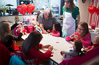 NWA Democrat-Gazette/CHARLIE KAIJO Engineers Pat Glisson (from center to right) and Dora Peoge helps girls with crafts, Sunday, February 11, 2018 at the Croppin' Train Hobby House in Bentonville. <br /><br />Girls brought their 18&quot; dolls to a Girls &amp; Dolls Valentine Party. The girls enjoyed a light luncheon, then some crafting for themselves and their dolls.<br /><br />Typically adult women will come to Hobby House and stay for a weekend retreat and scrapbook. The house provides beds for the women interested in staying for the weekend. They provide women a chance to get together and fellowship.