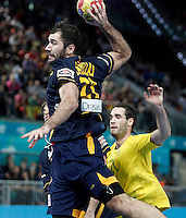 Spain's Joan Canellas (l) and Australia's Ognjen Matic during 23rd Men's Handball World Championship preliminary round match.January 15,2013. (ALTERPHOTOS/Acero) /NortePhoto
