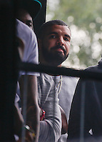 DRAKE waits to watch Jaden and Willow Smith Perform during The New Look Wireless Music Festival at Finsbury Park, London, England on Sunday 05 July 2015. Photo by Andy Rowland.