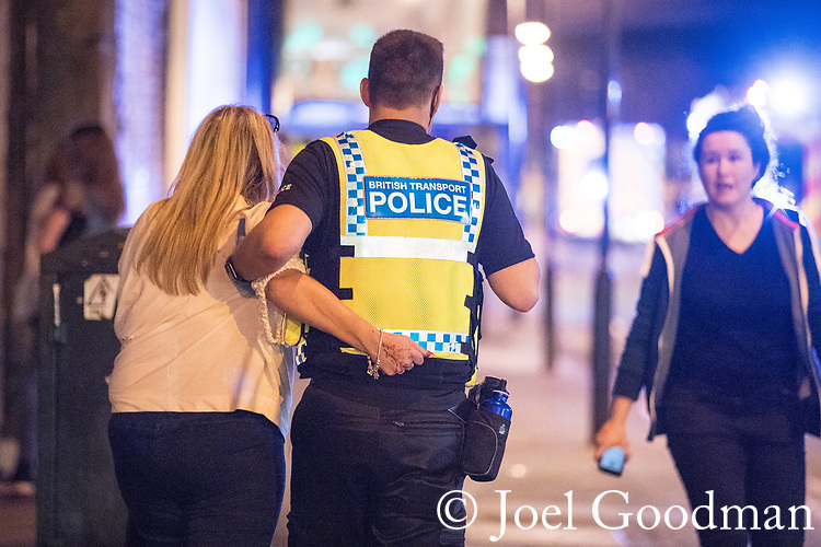 © Joel Goodman - 07973 332324 . 22/05/2017. Manchester, UK. Walking wounded on Hunts Bank outside Victoria Station and the stairs leading to the Manchester Arena . Police and other emergency services are seen near the Manchester Arena after reports of an explosion. Police have confirmed they are responding to an incident during an Ariana Grande concert at the venue. Photo credit : Joel Goodman