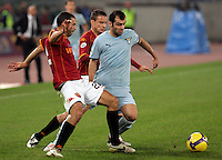 Calcio, Serie A: Roma vs Lazio. Roma, stadio Olimpico, 16 novembre 2008. .Football, Italian serie A: Roma vs Lazio. Rome, Olympic stadium, 16 november 2008..Lazio forward Goran Pandev, of Macedonia, right, is challenged by AS Roma defender Max Tonetto, left, and midfielder Matteo Brighi..UPDATE IMAGES PRESS/Riccardo De Luca