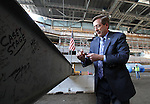 SIOUX FALLS, SD - OCTOBER 16:  Sioux Falls Mayor Mike Huether finishes signing his name on the last beam to be placed in the Denny Sanford Event Center that will enclose the building.  (Photo by Dave Eggen/Inertia)