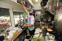 NWA Democrat-Gazette/ANDY SHUPE<br /> Zac Ramsey, head cook at The Green Goat, fills orders Thursday, May 25, 2017, for patrons on Martin Luther King Jr. Boulevard in south Fayetteville.