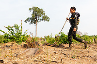 A military policeman during a patrol looking for illegal loggers, in the Phnom Tnout Phnom Pok Wildlife Sanctuary, in northern Cambodia.