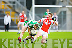 Chris O'Leary Kilcummin/Rathmore slides in to try to rob the ball frm Thomas Moriarty Legion during the County Champship final in Fitzgerald Stadium last Thursday evening