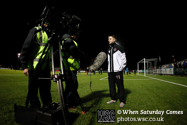 Llandudno 2 Denbigh Town 2, 20/03/2015. Maesdu Park, Huws Gray Alliance Football League. Lee Thomas of Llandudno doing a TV interview in Welsh. Needing a win to guarantee promotion to the top division of Welsh football for the first time, Llandudno took the lead twice, but were held to a draw against Denbigh Town.<br /> Llandudno installed an artificial 3G pitch in 2014. The pitch is available for hire, and enables to club to have an active community programme, and teams in every age range, all playing at Maesdu Park. Photo by Paul Thompson.