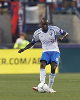 Montreal Impact defender Hassoun Camara (6) passes the ball. In a Major League Soccer (MLS) match, Montreal Impact defeated the New England Revolution, 1-0, at Gillette Stadium on August 12, 2012.