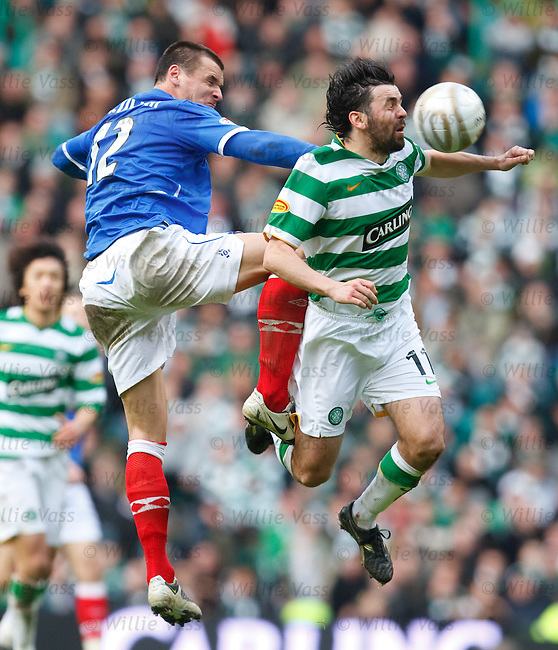 Lee McCulloch catches Paul Hartley in the small of his back