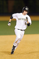 Evan Stephens (5) of the Wake Forest Demon Deacons hustles towards third base after hitting a triple against the High Point Panthers at Wake Forest Baseball Park on April 2, 2014 in Winston-Salem, North Carolina.  The Demon Deacons defeated the Panthers 10-6.  (Brian Westerholt/Four Seam Images)