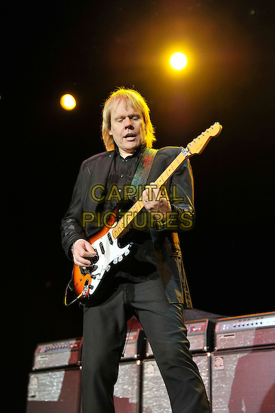 Styx - James Young.Styx performing live at Wembley Arena, London, England..June 4th, 2011.stage concert live gig performance music full length black  suit guitar half 3/4.CAP/MAR.© Martin Harris/Capital Pictures.