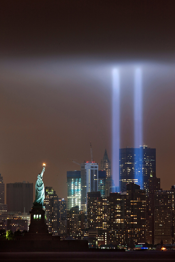 The Tribute in Light shines above lower Manhattan and the Statue of Liberty in New York, on the 10th anniversary of the September 11 attacks on the United States.
