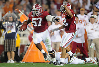 Jan 7, 2010; Pasadena, CA, USA; Alabama Crimson Tide defensive lineman Marcell Dareus (57) returns an interception return for a touchdown during the second quarter of the 2010 BCS national championship game against the Texas Longhorns at the Rose Bowl.  Mandatory Credit: Gary A. Vasquez-.