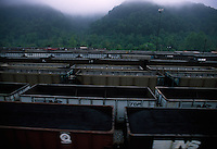 Coal trains lined up await being filled and will carry tons out of the mountains.