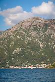MONTENEGRO, Bay of Kotor, Mountains rise above sailboats on the Bay of Kotor, Ben M Thomas