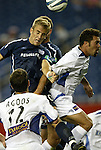 04 September 2004: Taylor Twellman (front), Pat Noonan (rear), and Troy Dayak (right) jump above Jeff Agoos (12) to challenge for a header in the second half. The San Jose Earthquakes defeated the New England Revolution 1-0 at Gillette Stadium in Foxboro, MA during a regular season Major League Soccer game..