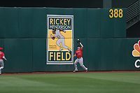 OAKLAND, CA - SEPTEMBER 4:  Mike Trout #27 of the Los Angeles Angels of Anaheim makes a catch in center field against the Oakland Athletics during the game at the Oakland Coliseum on Monday, September 4, 2017 in Oakland, California. (Photo by Brad Mangin)