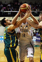Tall Blacks centre Rob Loe's way is blocked by Oscar Foreman and AJ Ogilvy during the International basketball match between the NZ Tall Blacks and Australian Boomers at TSB Bank Arena, Wellington, New Zealand on 25 August 2009. Photo: Dave Lintott / lintottphoto.co.nz