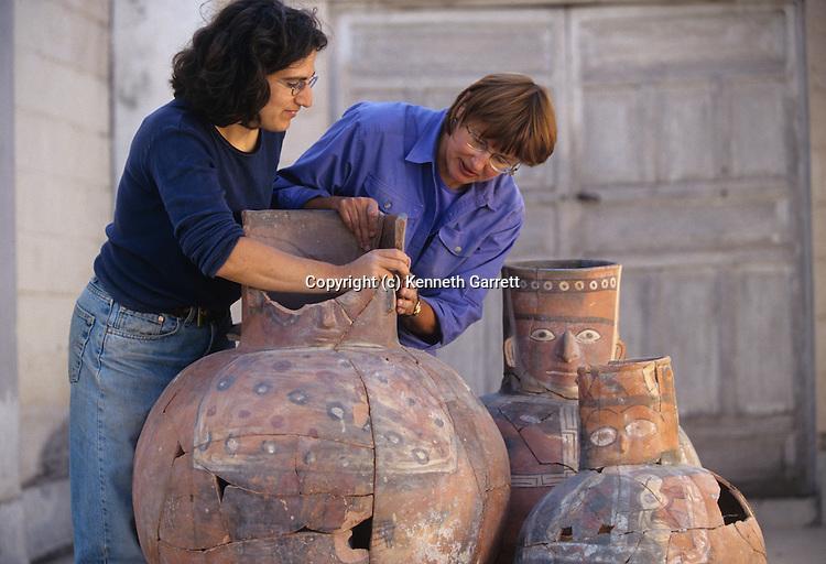 Restoration of large face neck jars, Wari, Huari, Empires of the Sun, Peru