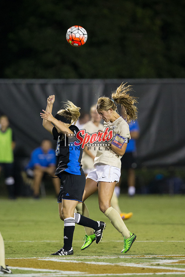 Sarah Teegarden (7) of the Wake Forest Demon Deacons battles for a jump ball with Claire Winter (25) of the UCLA Bruins during second half action at Spry Soccer Stadium on September 11, 2015 in Winston-Salem, North Carolina.  The Bruins defeated the Demon Deacons 2-1.  (Brian Westerholt/Sports On Film)