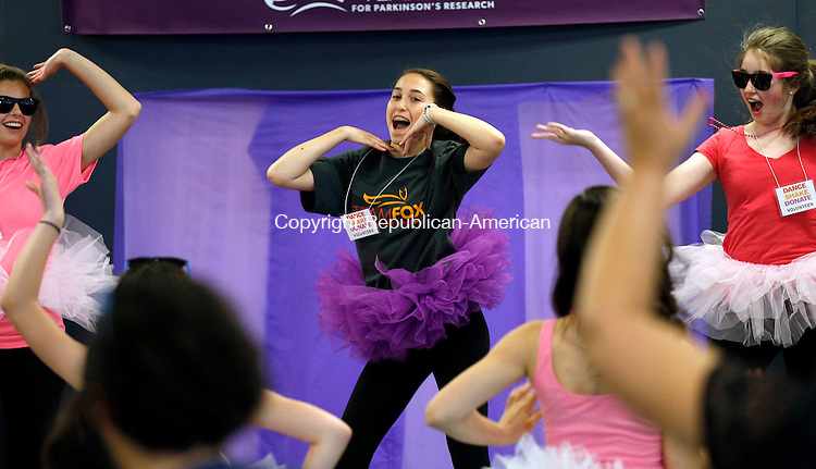 Waterbury, CT- 14 June 2015-061415CM10- Zoe Butchern, 14, of Ridgefield, center, dances during A Shake-It-Off-A-Thon, to benefit the Michael J. Fox Foundation for Parkinson's research at Raymour & Flanigan in Waterbury on Sunday.  Butchen a student at Ridgefield High School said 100% of the proceeds will go to the Michael J. Fox Foundation for Parkinsons.  Her father, Jeff Butchen was diagnosed with the disease, an event that inspired her to raise money for the foundation.   Christopher Massa Republican-American