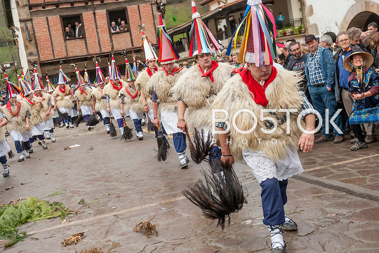 "People dressed up in ""Joaldunak"" (""those who play the bell"") costume perform during the celebration of an ancient traditional carnival. Ituren (Basque Country). February 1, 2016. The ""Joaldunak"" (""those who play the bell"") is a character that takes part in the carnival at the villages of Ituren and Zubieta carrying sheep furs and big cowbells tied to their backs to wake up the earth, looking for a good new year, a good harvest and to keep away the bad spirits.  (Gari Garaialde / BostokPhoto)"