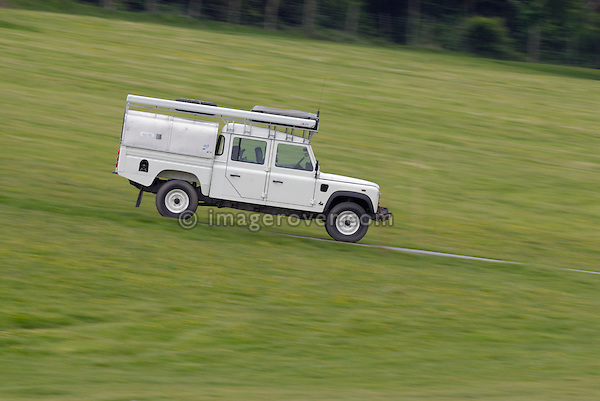 White Land Rover Defender 130 Crew Cab at the ALRC National 2008. The Association of Land Rover Clubs (ALRC) National Rallye is the biggest annual motor sport oriented Land Rover event and was hosted 2008 by the Midland Rover Owners Club at Eastnor Castle in Herefordshire, UK, 22 - 27 May 2008. --- No releases available. Automotive trademarks are the property of the trademark holder, authorization may be needed for some uses.