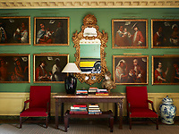 Mexican casta paintings, depicting mixed-race families, flank an 18th century gilt-wood mirror by Matthias lock in the sitting room; the Chinese Chippendale chairs against the wall date from 1768.
